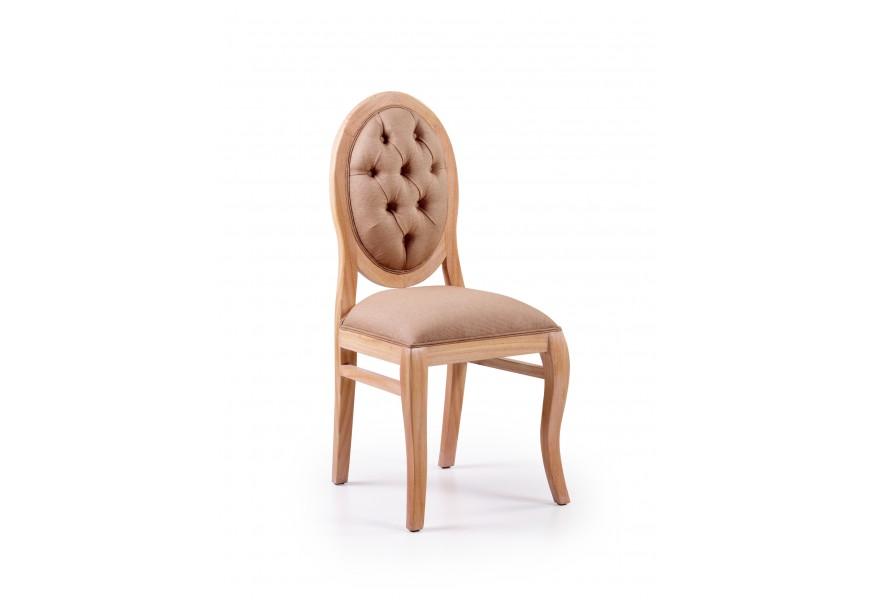 Luxusná elegantná čalúnená stolička Bromo je vyrobená z exotického dreva Mindi, ktoré je veľmi cenené pre svoje vlastnosti