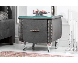 Jedinečný moderný čalúnený nočný stolík Caledonia v sivom prevedení so zásuvkou na kovovým nohách a so sklenenou doskou