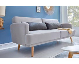 Dizajnová rozkladacia sedačka Sheena v škandinávskom štýle s poťahom sivej farby, s masívnymi nohami a s čiernymi vankúšmi