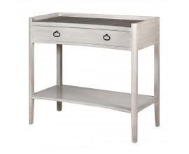 Vintage konzolový stolík Celene IV v bielych provensálskych odtieňoch masívneho dreva je doplnený kovovými úchytmi na zásuvke a