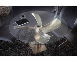 Okrúhly jedálenský stôl z kovu a skla v tvare lodnej skrutky v striebornom prevedení s okrúhlou doskou zo skla 94cm