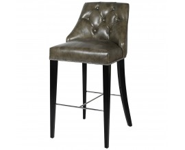 Chesterfield kožená zelenohnedá barová stolička Selmano s drevenými nohami a striebornými prvkami 110cm