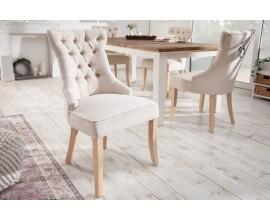 Chesterfield krémová jedálenská stolička Torino s textilným poťahom s kruhovým klopadlom a drevenými nohami