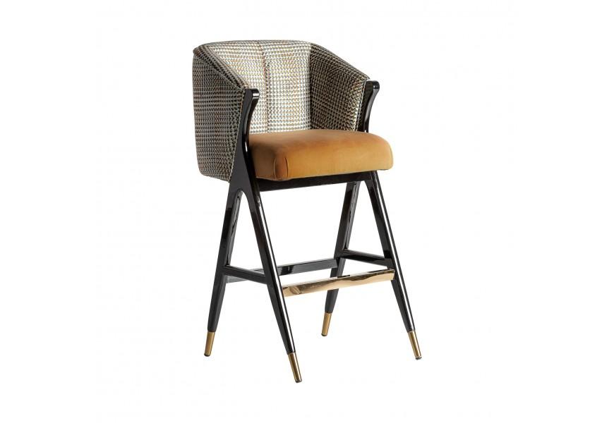 Štýlová čalúnená horčicová Art-deco barová stolička Brilon s čiernou konštrukciou z dreva a zlatými prvkami