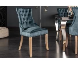 Štýlová jedálenská stolička Torino s tmavomodrým zamatovým poťahom s chesterfield prešívaním a strieborným klopadlom 96cm