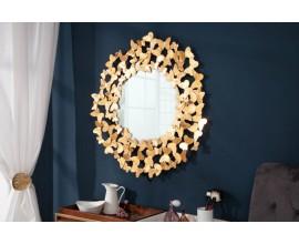 Moderné kruhové nástenné zrkadlo Papillon v deokračnom ráme so zlatým povrchom