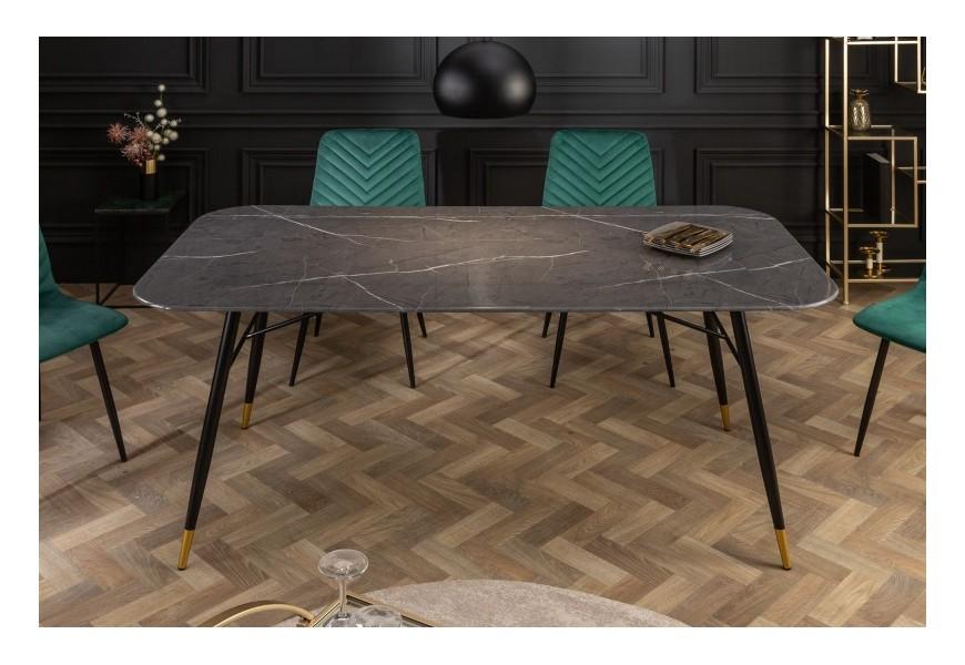 Luxusný čierny obdĺždnikový jedálenský stôl Forisma s vkusnými kovovými nohami so zakončením zlatej farby