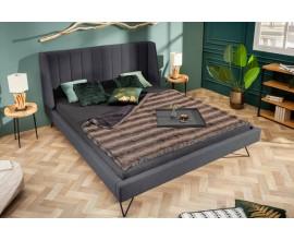 Jedinečná a nadčasová sivá čalúnená manželská posteľ Tesinna v art-deco štýle na nožičkách