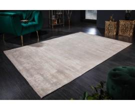 Elegantný vintage obdĺžnikový koberec Adassilv béžovej farbe s vypraným efektom