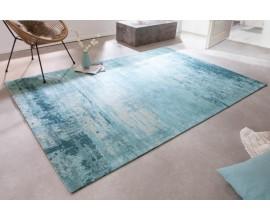 Štýlový bavlnený obdĺžnikový koberec Vernon v tyrkysovej farbe s vypraným efektom