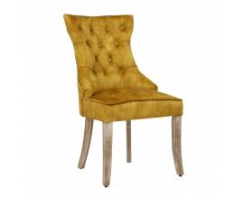 Chesterfield jedálenská stolička Torino zo zamatu s drevenými nohami a strieborným klopadlom v horčicovožltom prevedení