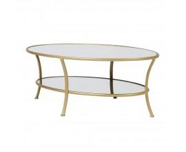 Art-deco oválny konferenčný stolík Eldera v zlatej farbe z kovu a skla 119cm