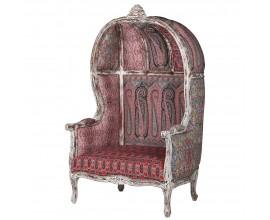 Vintage ornamentálne kreslo Alia so vzorovaným červeným poťahom a masívnymi nožičkami 167cm