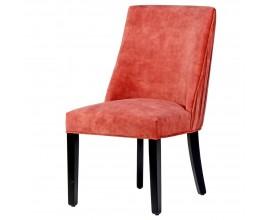 Dizajnová lososová jedálenská stolička Coral so zamatovým poťahom a s elegantými čiernymi nohami z masívu