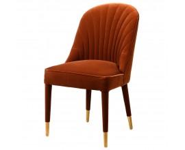 Art-deco štýlová stolička Célestine v hrdzavo oranžovom zamatovom prevedení so zlatým zakončením na nožičkách