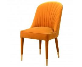 Art-deco štýlová stolička Célestine v horčicovom žltom zamatovom prevedení so zlatým zakončením na nožičkách