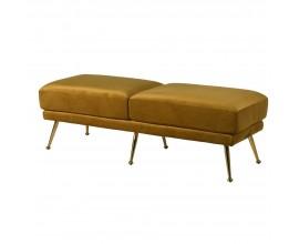 Art-deco lavica so zamatovým poťahom v horčicovom odtieni s lesklými nohami z chrómu v zlatej farbe 135 cm