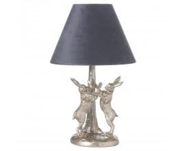 Art-deco stolná lampa Pochodujúci Zajaci v striebornom prevedení so sivým tienidlom