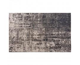 Nadčasový béžový vintage obdĺžnikový koberec Solapur s abstraktným vzorom čiernej farby