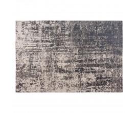 Luxusný béžový vintage obdĺžnikový koberec Solapur s abstraktným vzorom čiernej farby