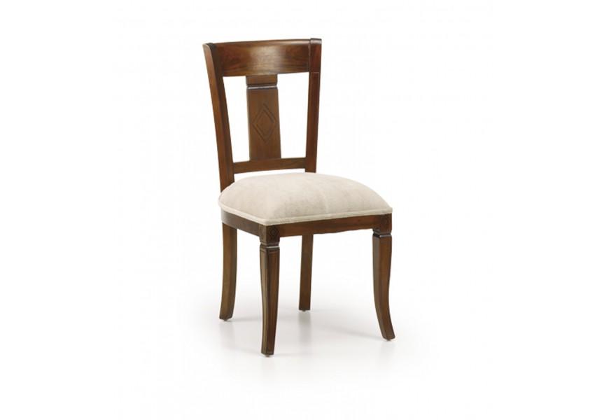 Koloniálna jedálenská stolička M-Vintage z masívu s béžovým poťahom a vyrezávaným operadlom